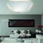 Infrarot-Heizungen: ein Wohnzimmer mit einer modernen Infrarot-Heizung über der Sitzecke. Eine Heizung an der Wand kombiniert mit einem LED-Rahmen ...